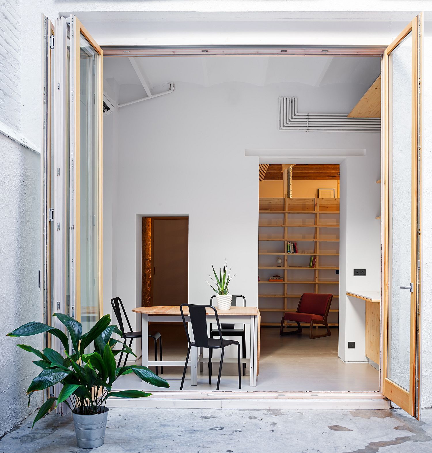 Dining area connected with the patio of the small Barcelona apartment