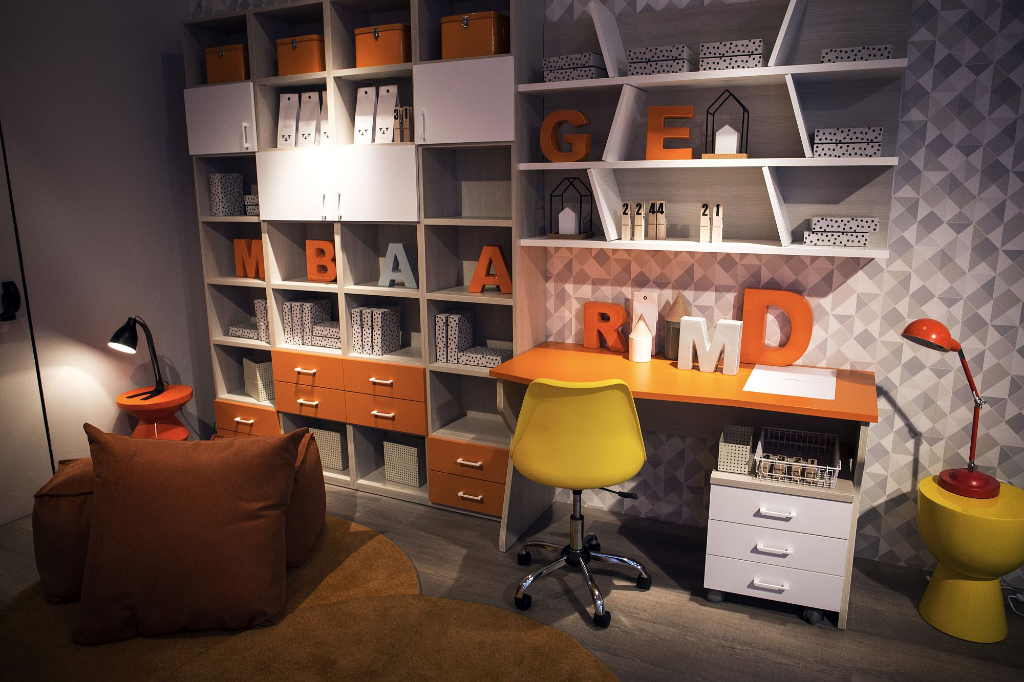 Modular shelving coupled with smart workstation and pops of yellow and orange
