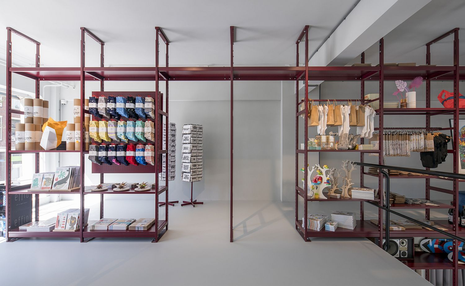 Simple and industrial style shelving provides ample display space