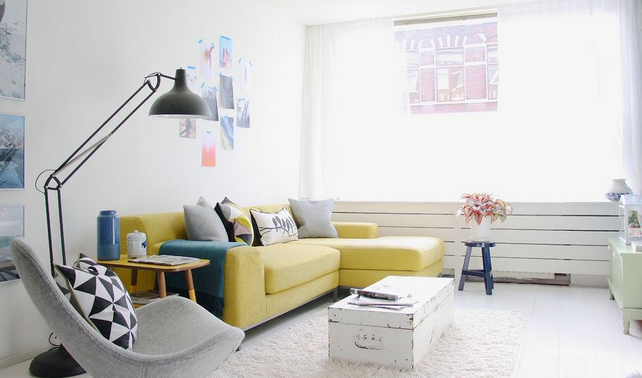 Yellow sofa uplifts the mood in a white living room