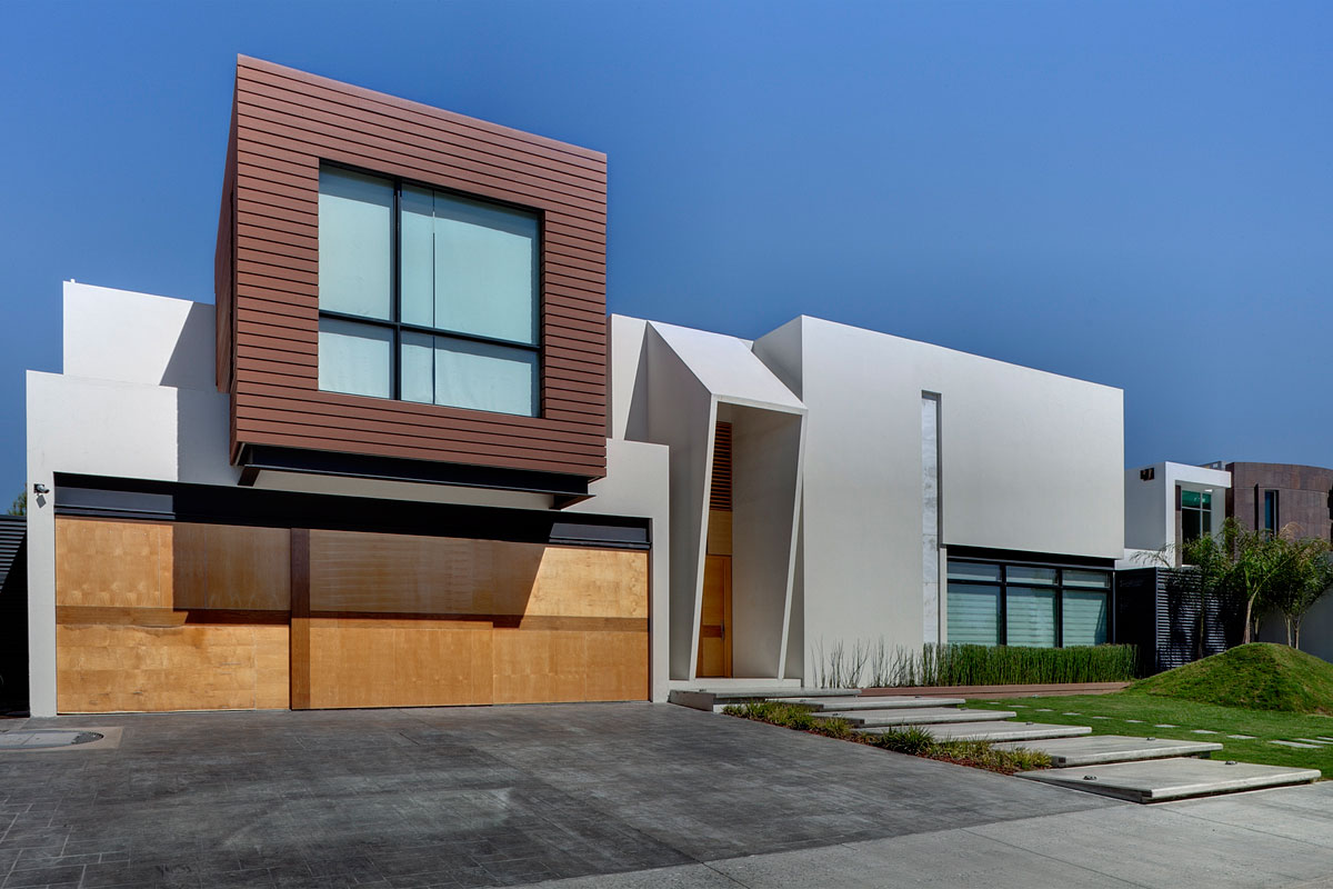 Contemporary home with a neutral asphalt driveway