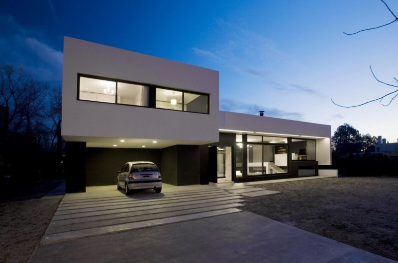 Gray concrete driveway for a modern monochrome house