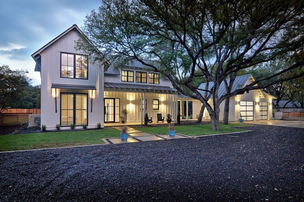 Modern farmhouse with a contrasting dark driveway