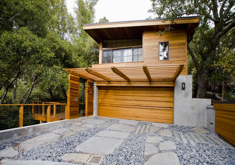 Organic modern driveway built from stones and pebbles