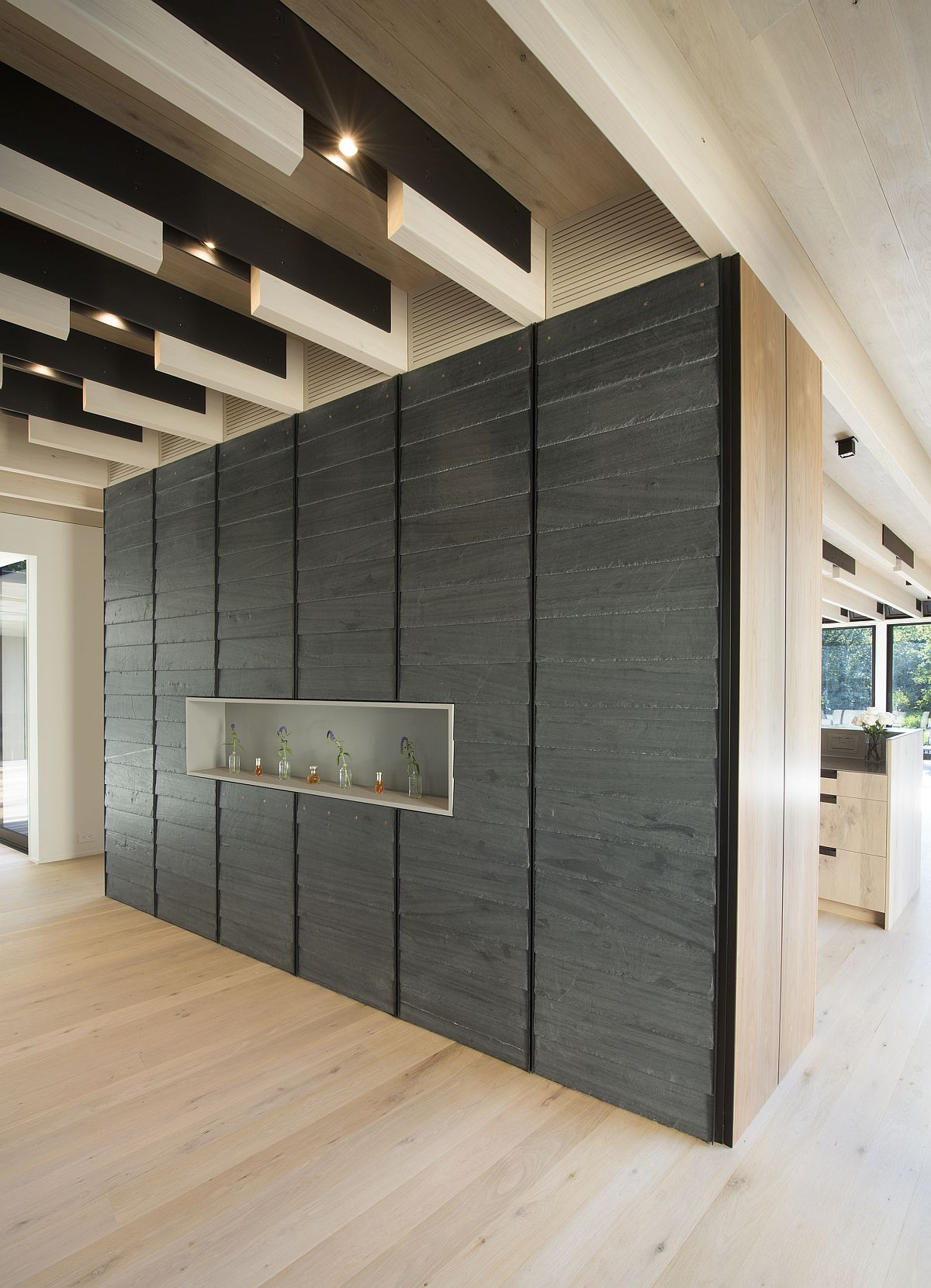 Textural contrast brought in by accent wall in the spacious home
