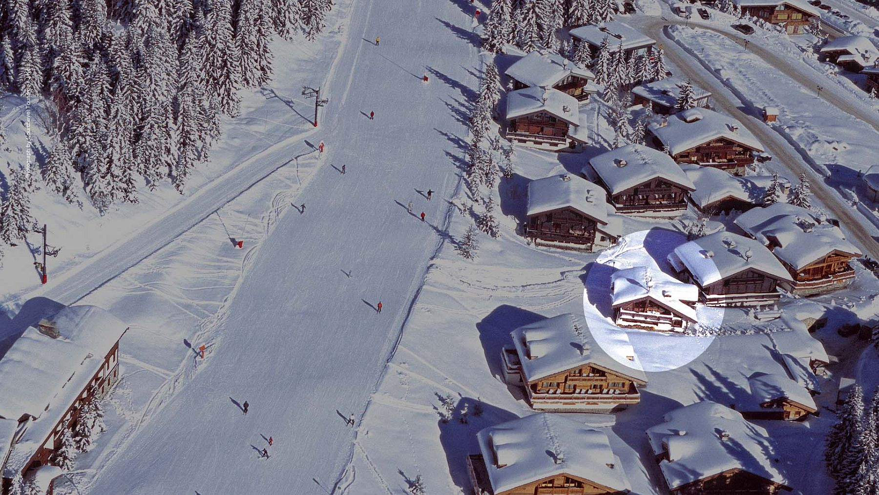 Aerial view of Chalet Le Namaste with ski slopes around it