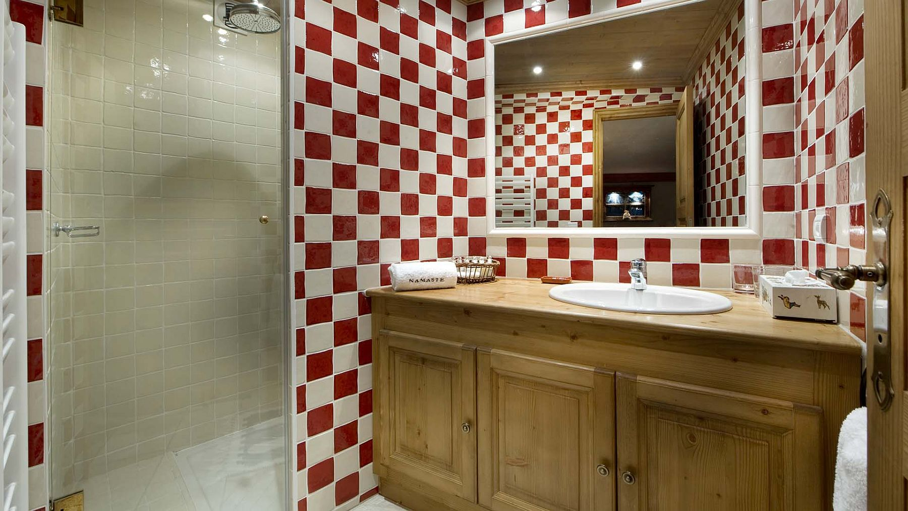 Bathroom in red and white and wooden vanity
