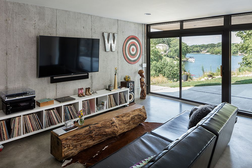 Family room with a rustic wooden coffee table and a concrete wall
