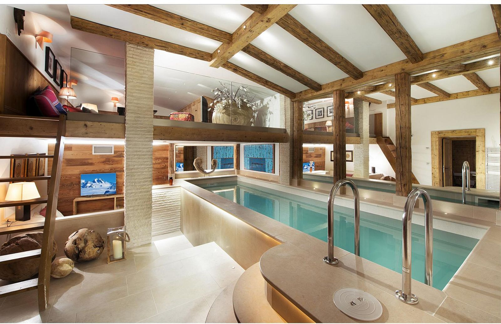 Indoor swimming pool, play area and kids room at the alpine French chalet
