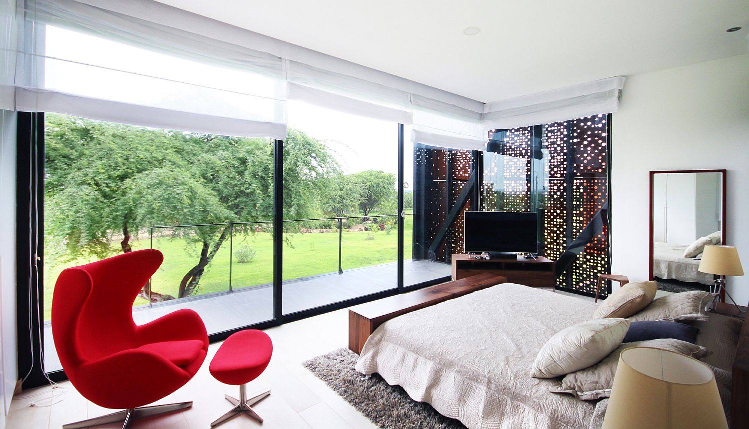 Pops of red enliven the contemporary interior