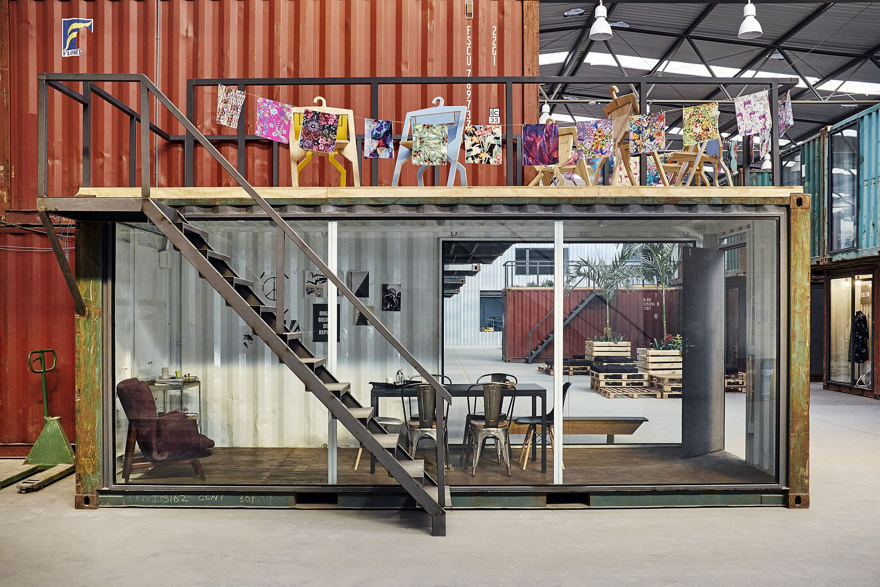 Repurposed shipping containers add to the sustainable style of the shed