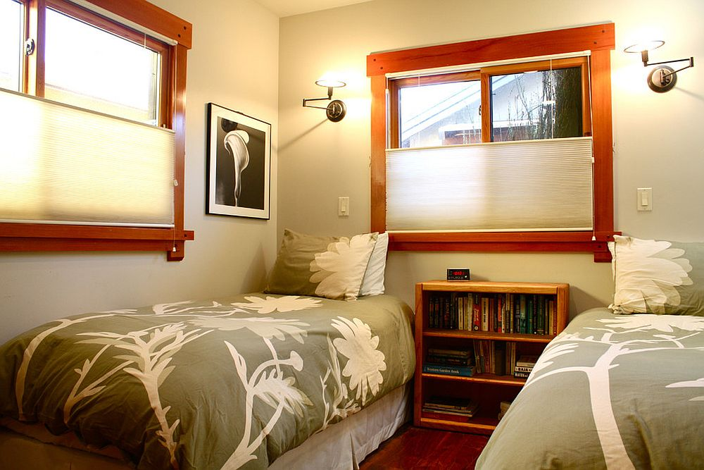 Twin bed guest room with ample space for books and accessories