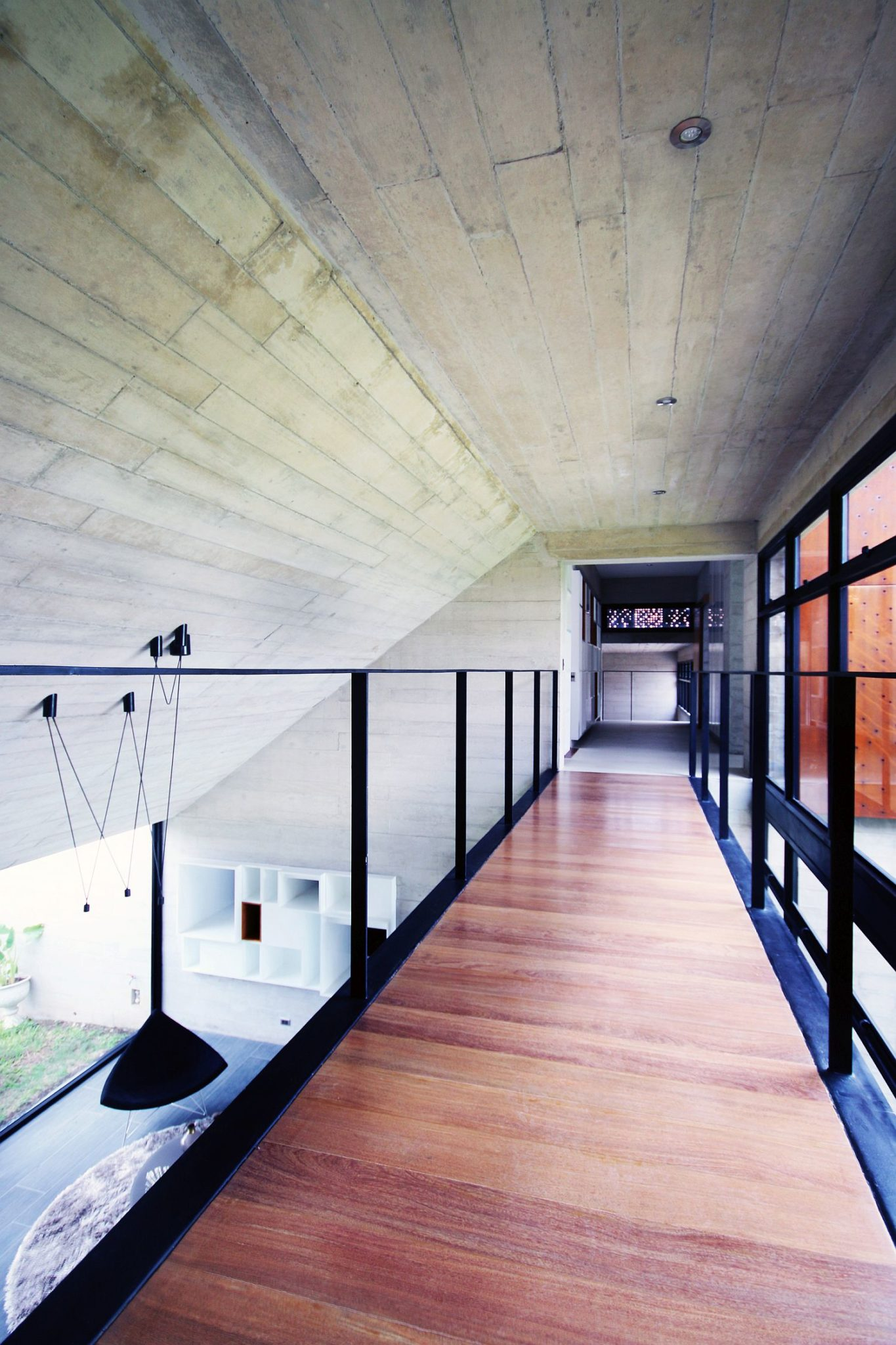 Walkway connecting the two upper levels of the home