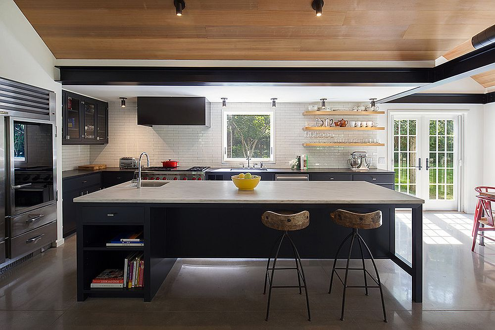 Contemporary kitchen with tiled backsplash and concrete floor