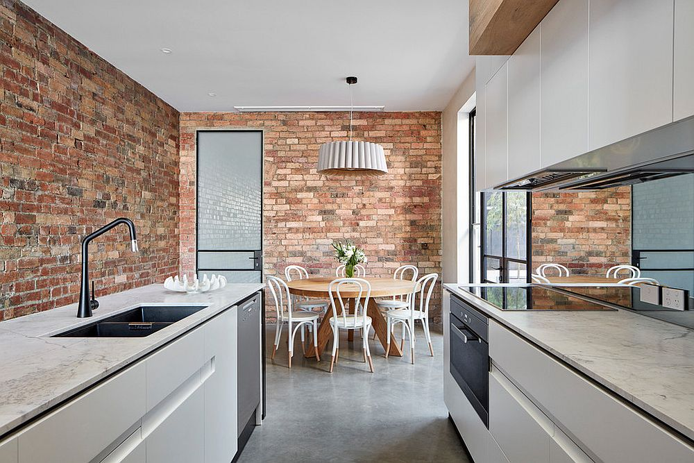 Modern kitchen with brick walls and space-savvy arrangement
