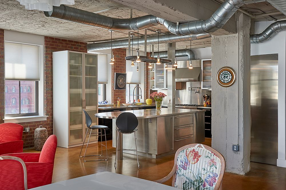 Modern industrial kitchen of revamped apartment in Mather Building
