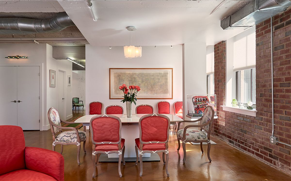 Plush chairs in pink add color to the interior
