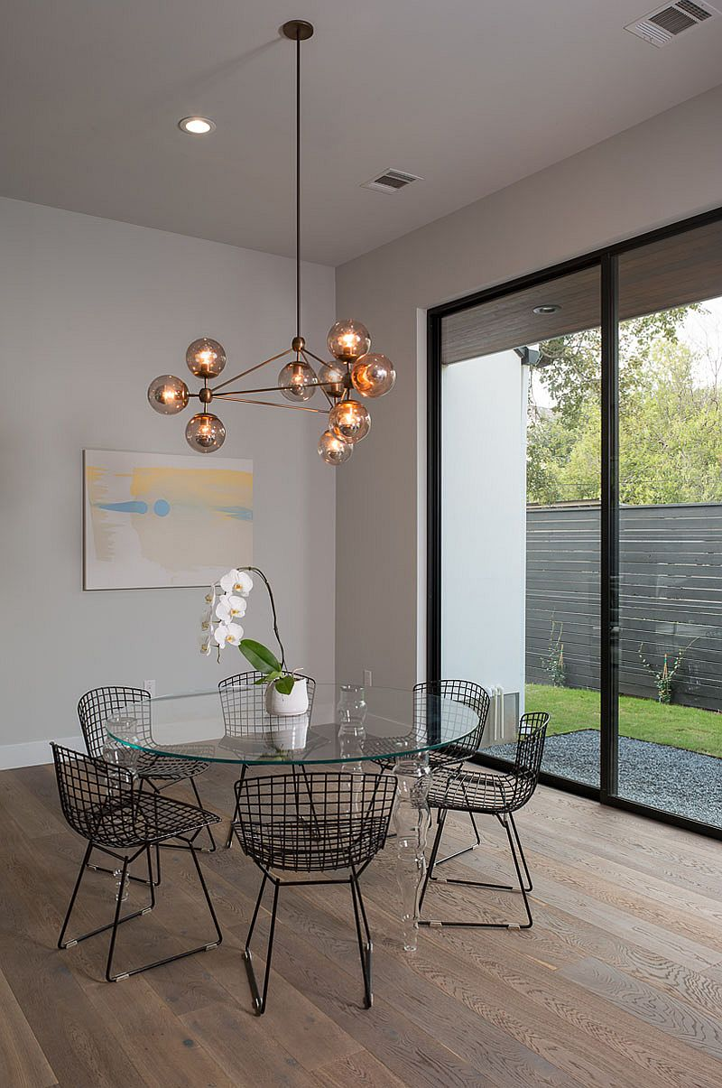 Sparkling chandelier becomes the focal point of the dining area