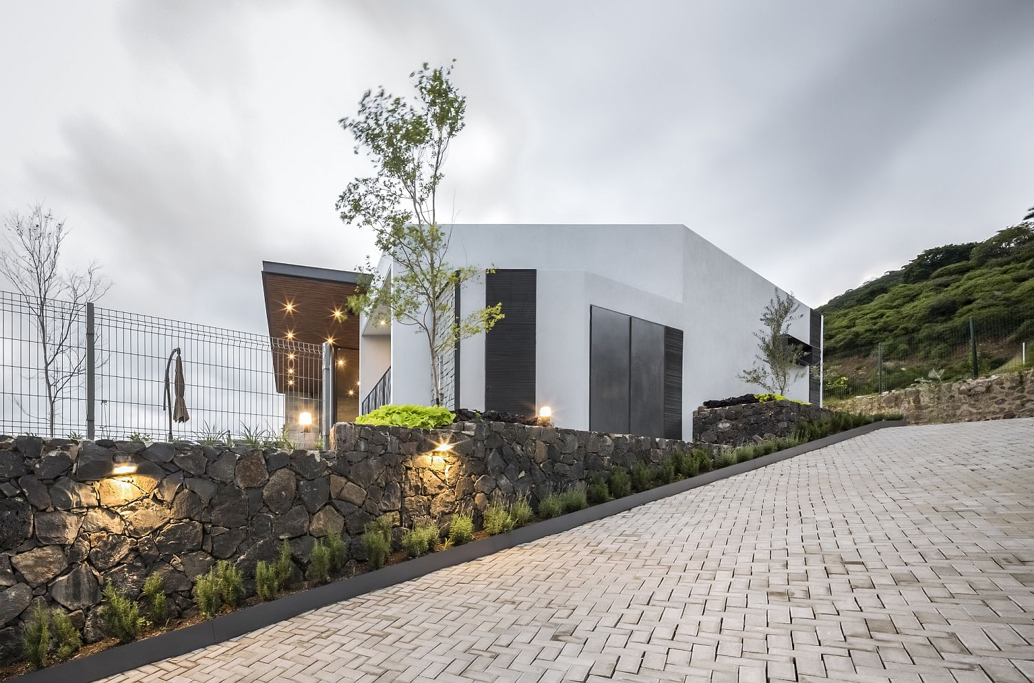 Stone walls give the entry a unique and yet modern look