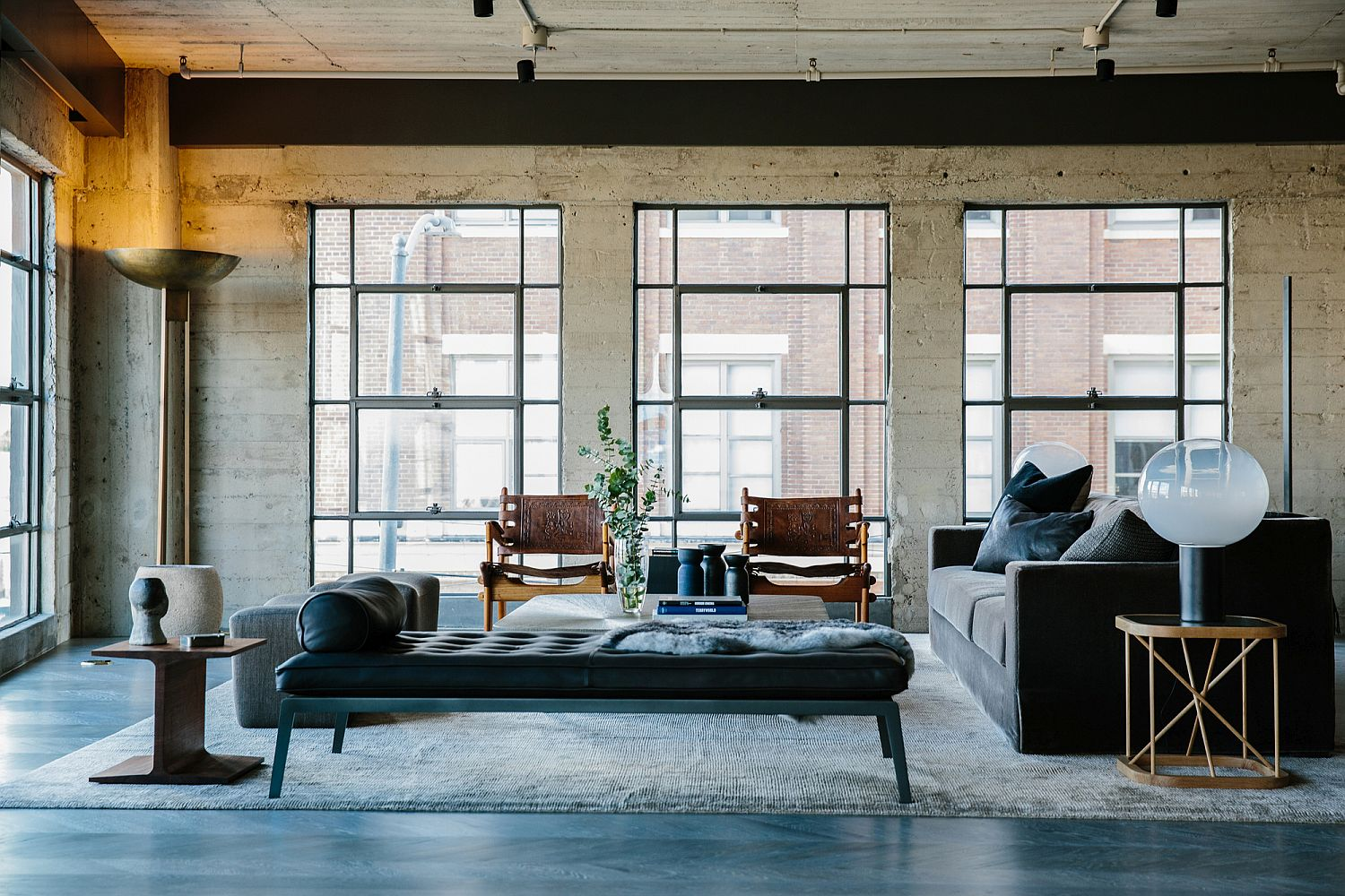 Exposed concrete walls and a polished floor blend in beautifully with the industrial vibe of the home
