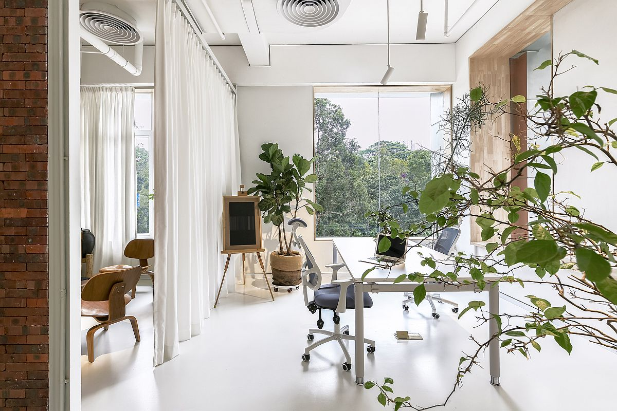 Tall white drapes act as room dividers when needed