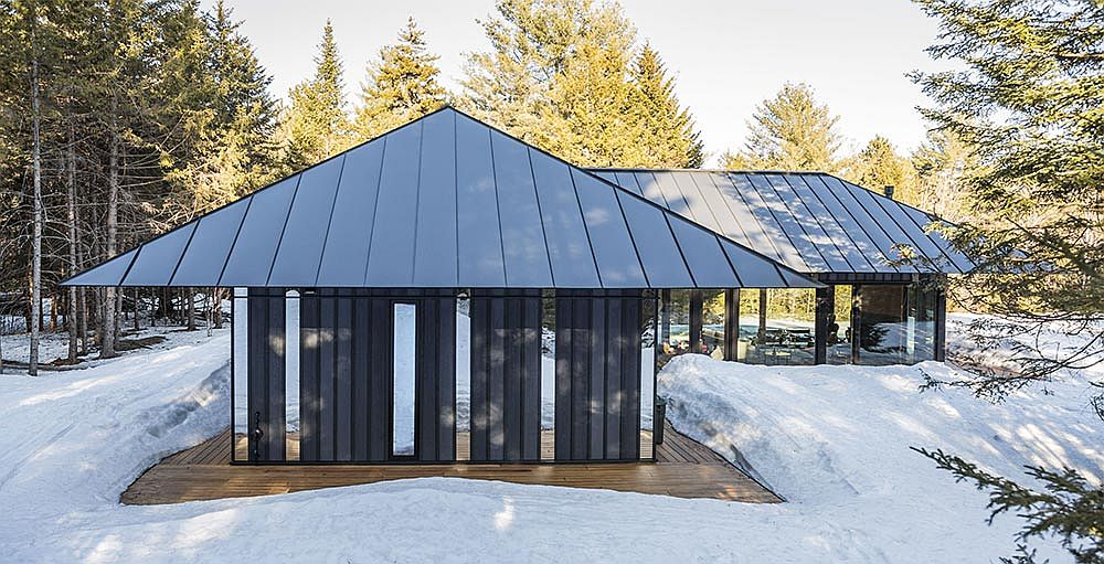 Board + Batten guest house with its distinctive roof and exterior