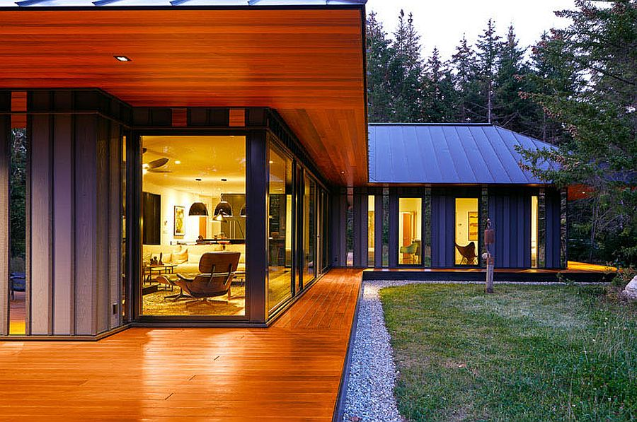 Corner windows of the Vermont retreat give a glimpse of the polished interior