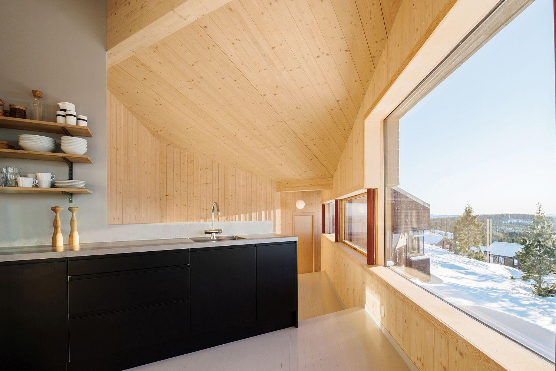 Dark kitchen island complements the dark exterior of the cabin
