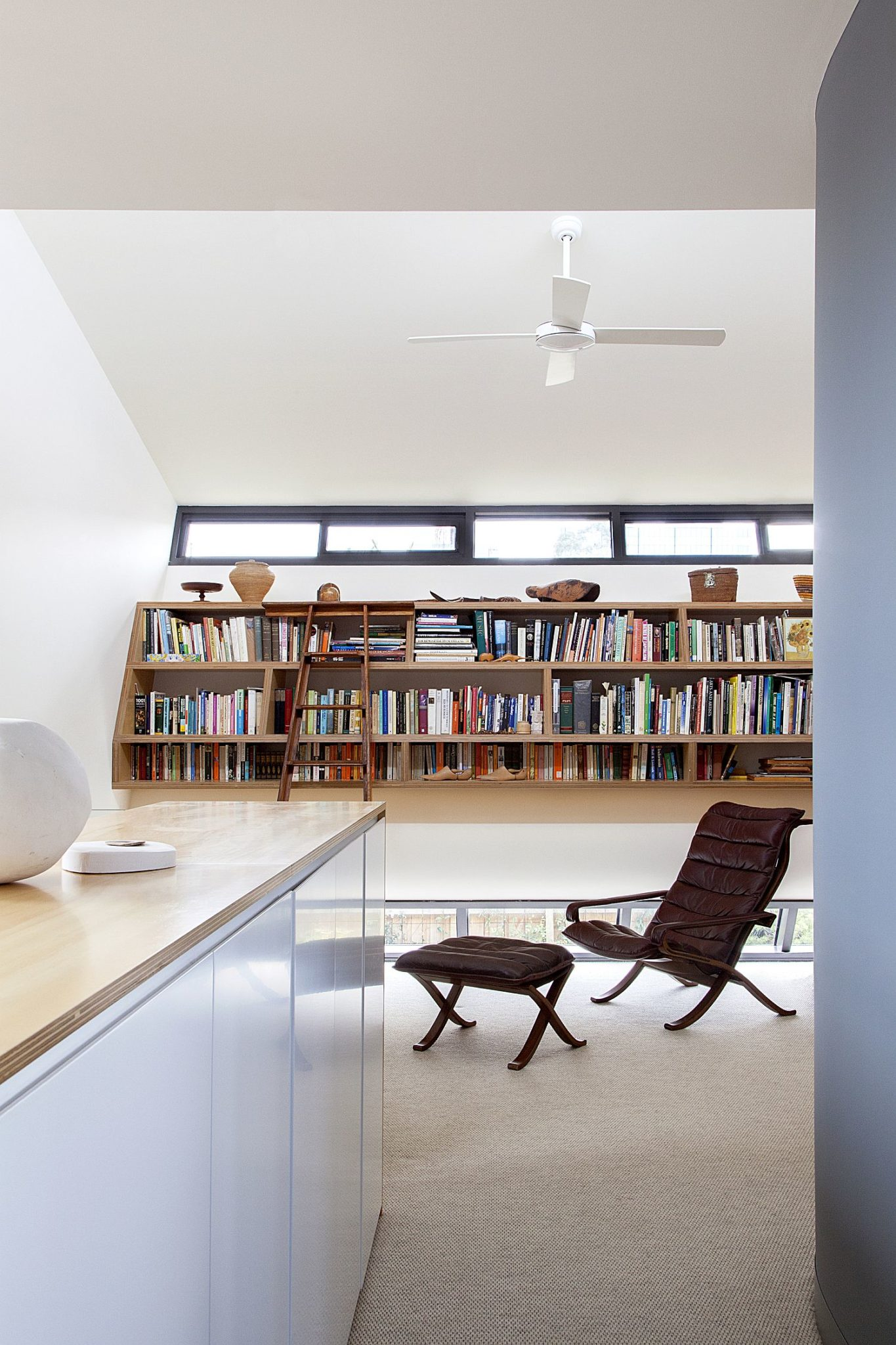 Home office in white with ample shelf space for books