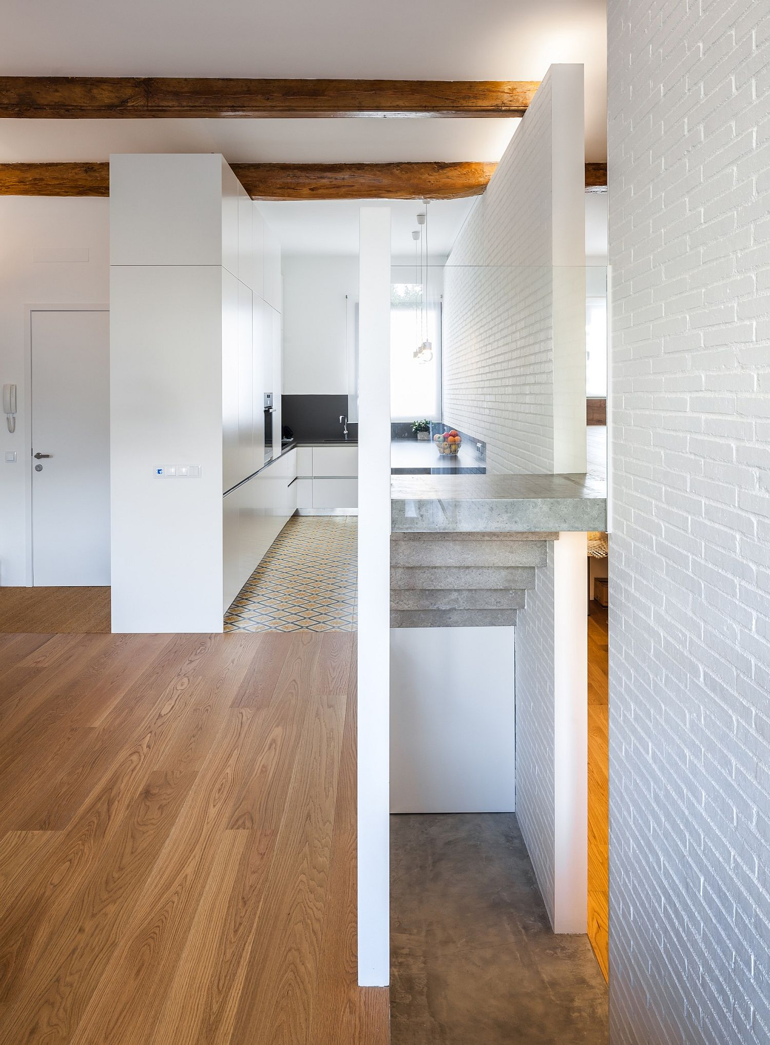 Small corner kitchen in white with wooden flooring