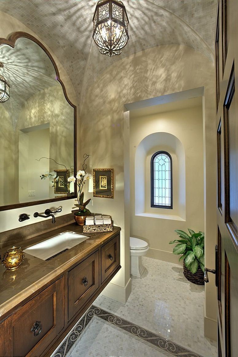Curved ceiling and custom Moroccan lighting for the Mediterranean powder room