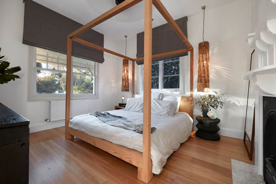 Bedroom inside the heritage structure of the revamped Aussie home