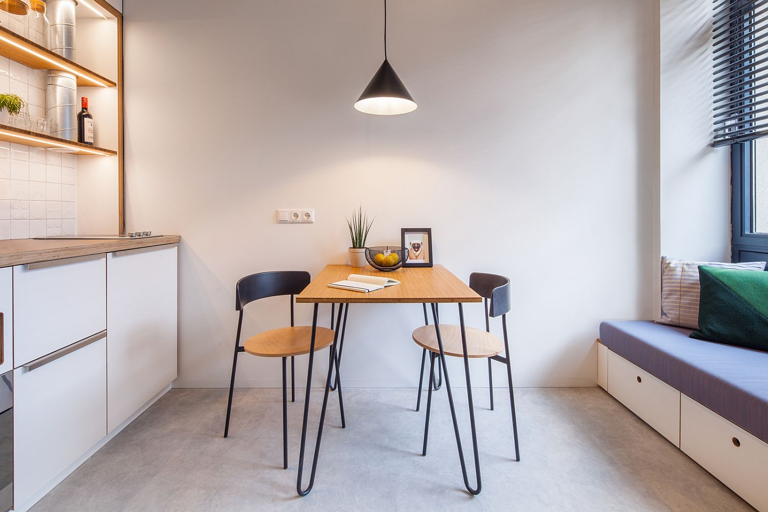 Tiny dining area between the small living area nook and the kitchen