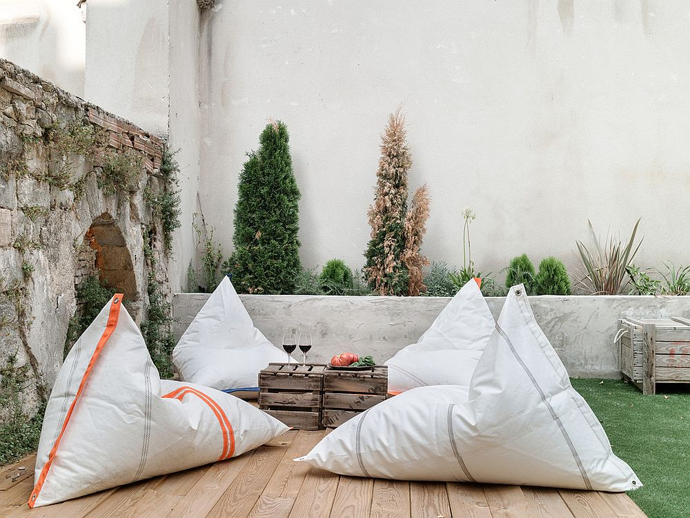 Bean bags and wooden crates turn the outdoor deck into a cozy hangout