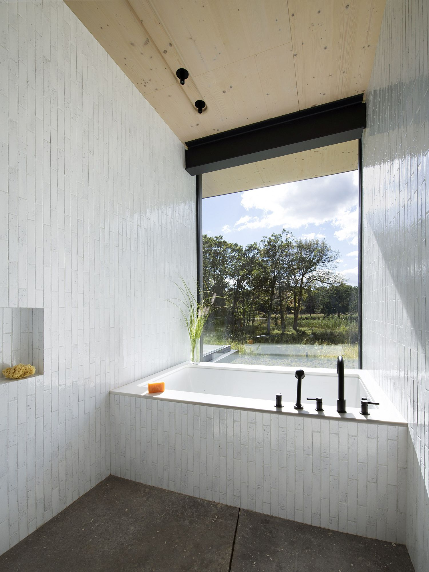 Contemporary tiled bathroom with a large window