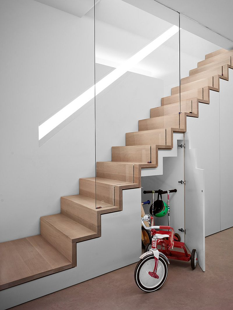 Light-filled contemporary stairway with smart storage area underneath