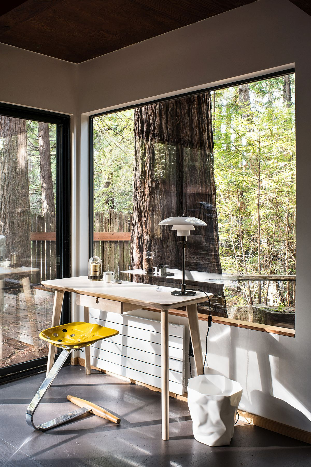 Beautiful work area of the cabin with forest view outside