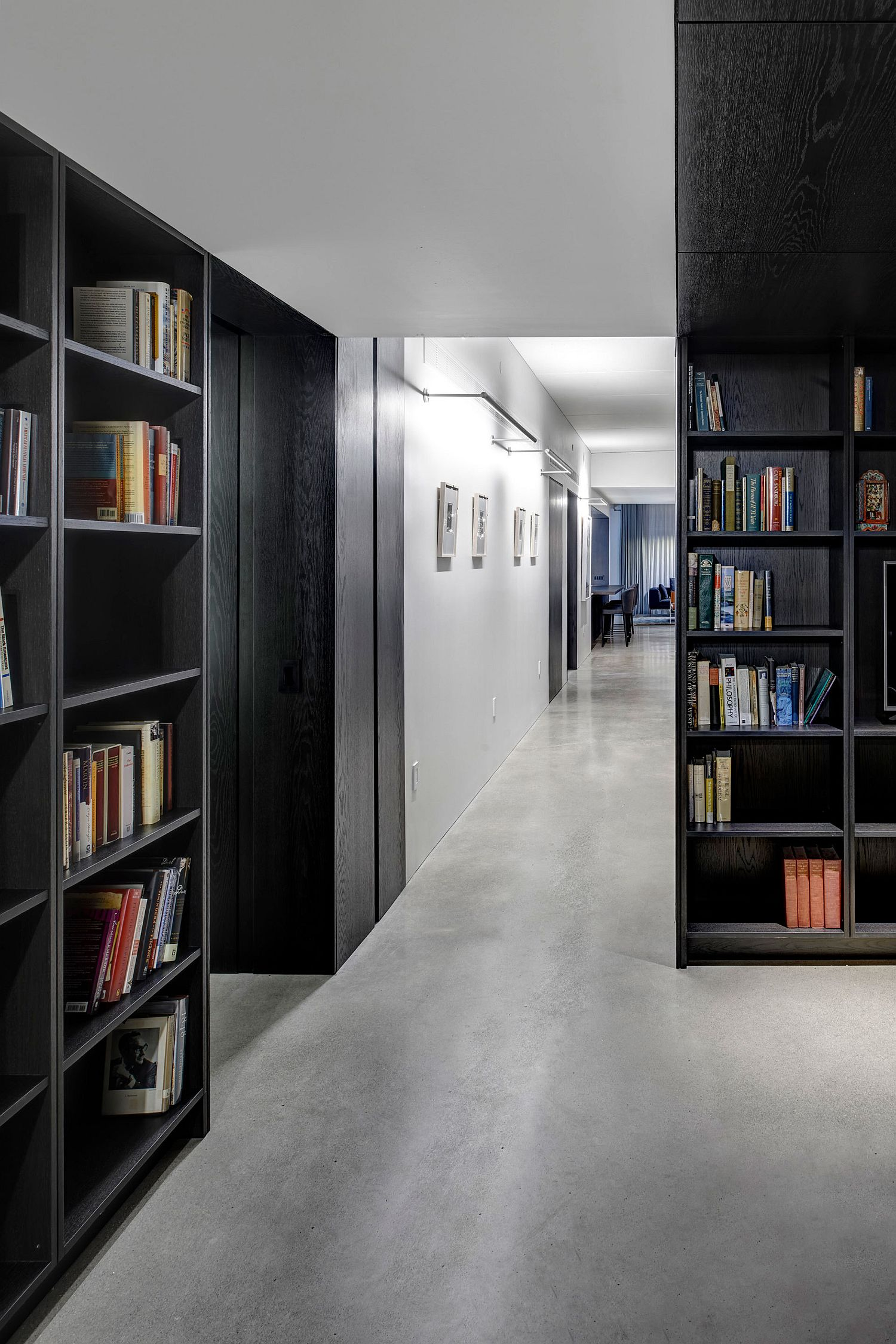 Bookshelves crafted using dark wooden elements make a big impact