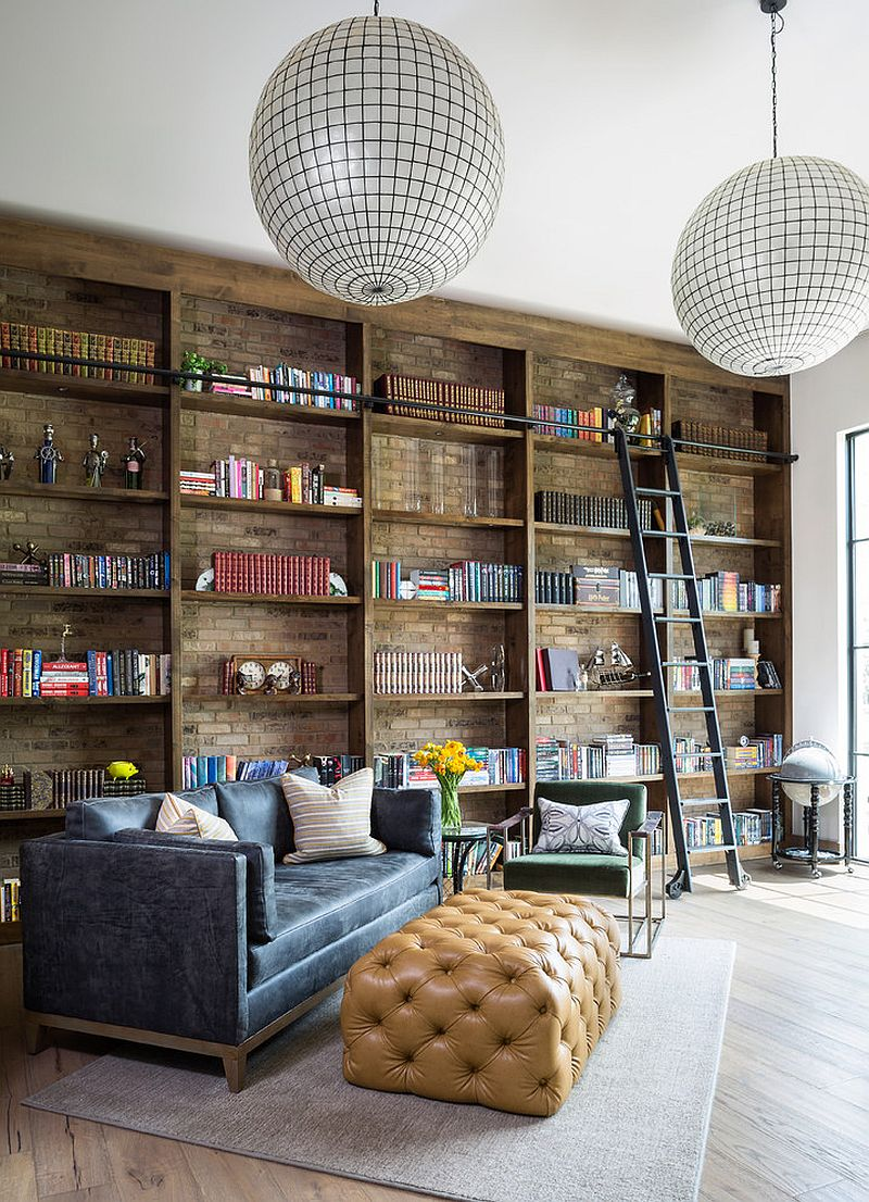 Brick wall in the backdrop adds beauty to the open shelves in wood inside the home office