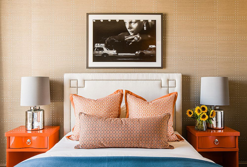 Contemporary bedroom with a dashing accent wall with orange nightstands