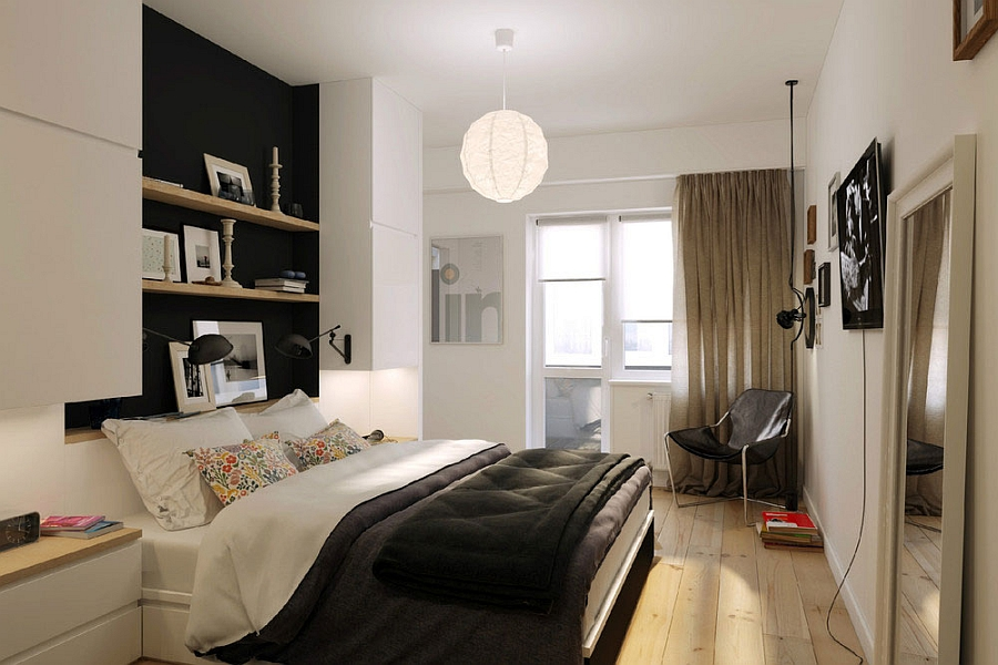 Small bedroom of the apartment with shelving above the bed