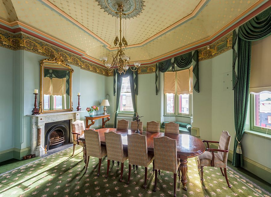 Victorian style dining room with ornate ceiling
