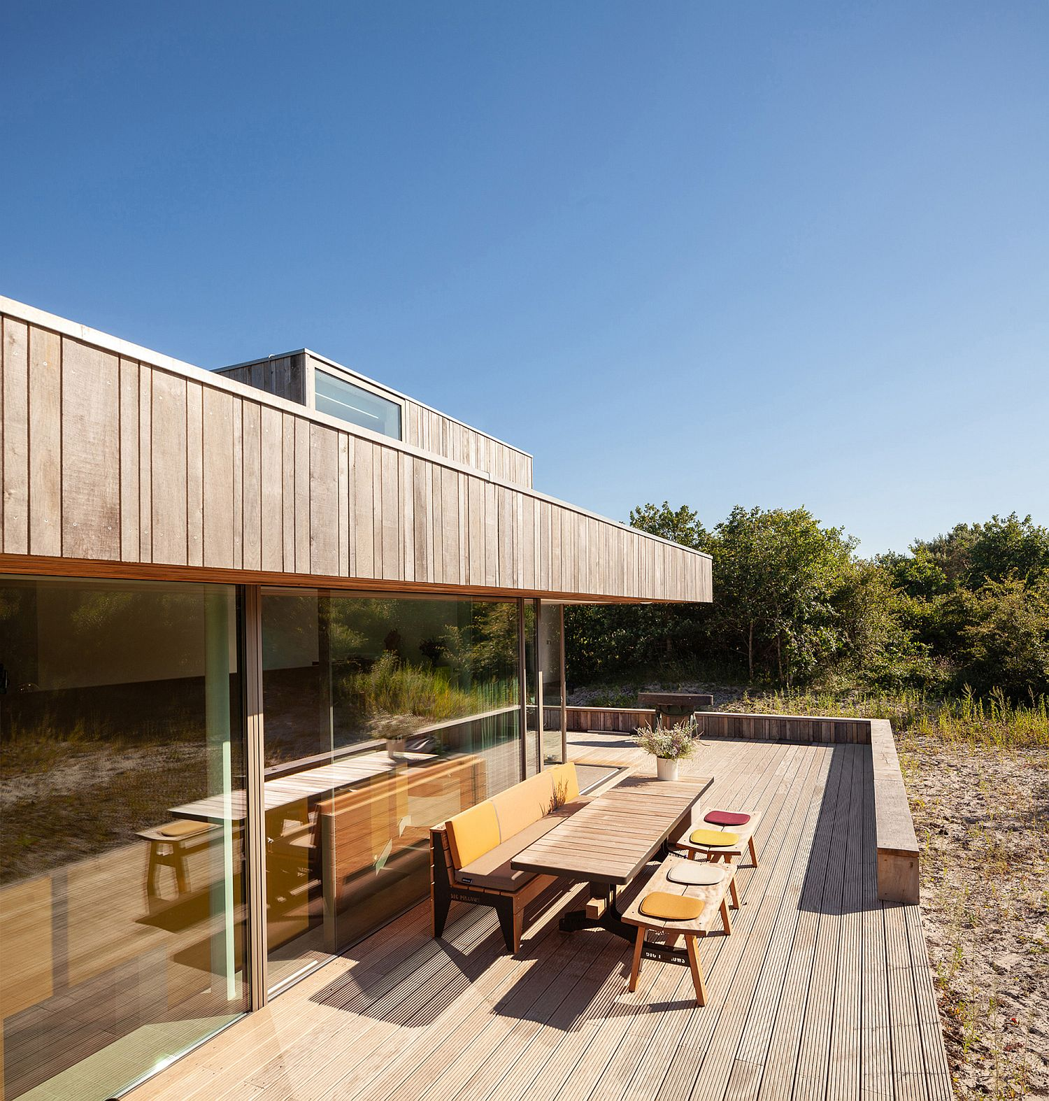 Sweeping wooden deck outside offers connectivity with nature