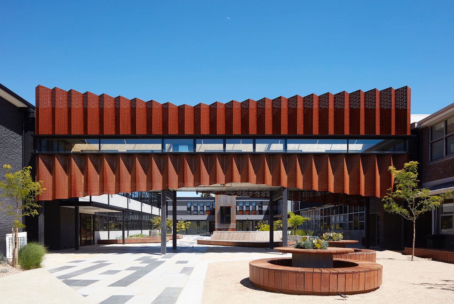 Zig-zag corten panels for the exterior of Flyover Gallery at Caroline Chisholm College