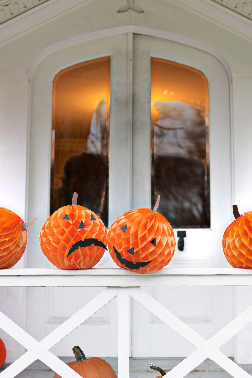 Orange tissue paper replaces pumpkins in this cool Halloween decorating idea