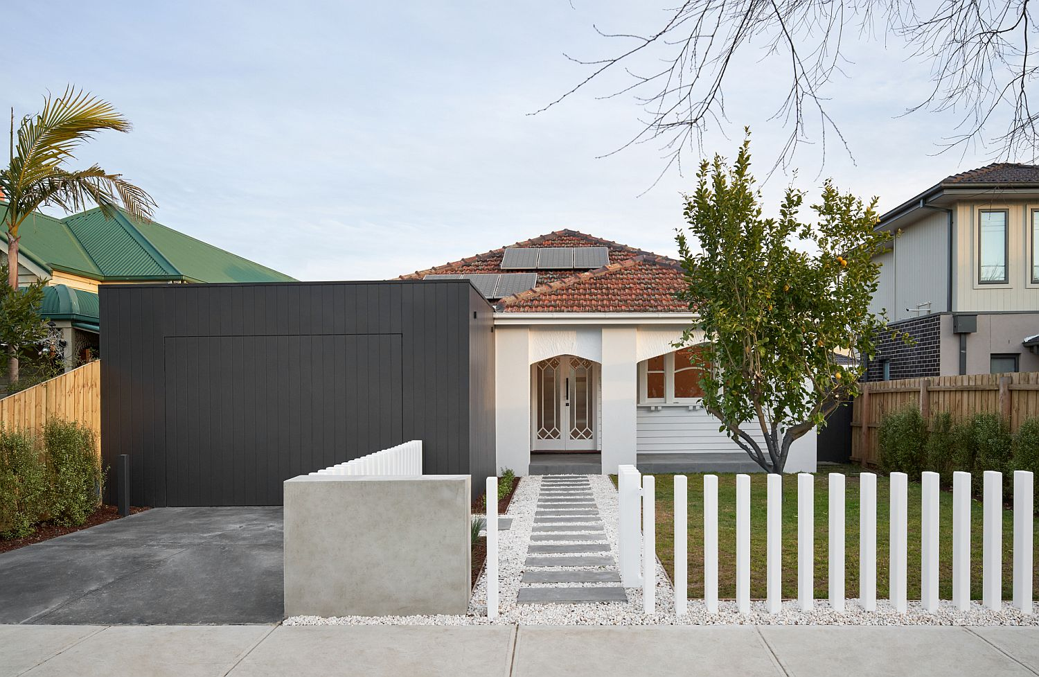 Street facade of the Melbourne House with modern extension
