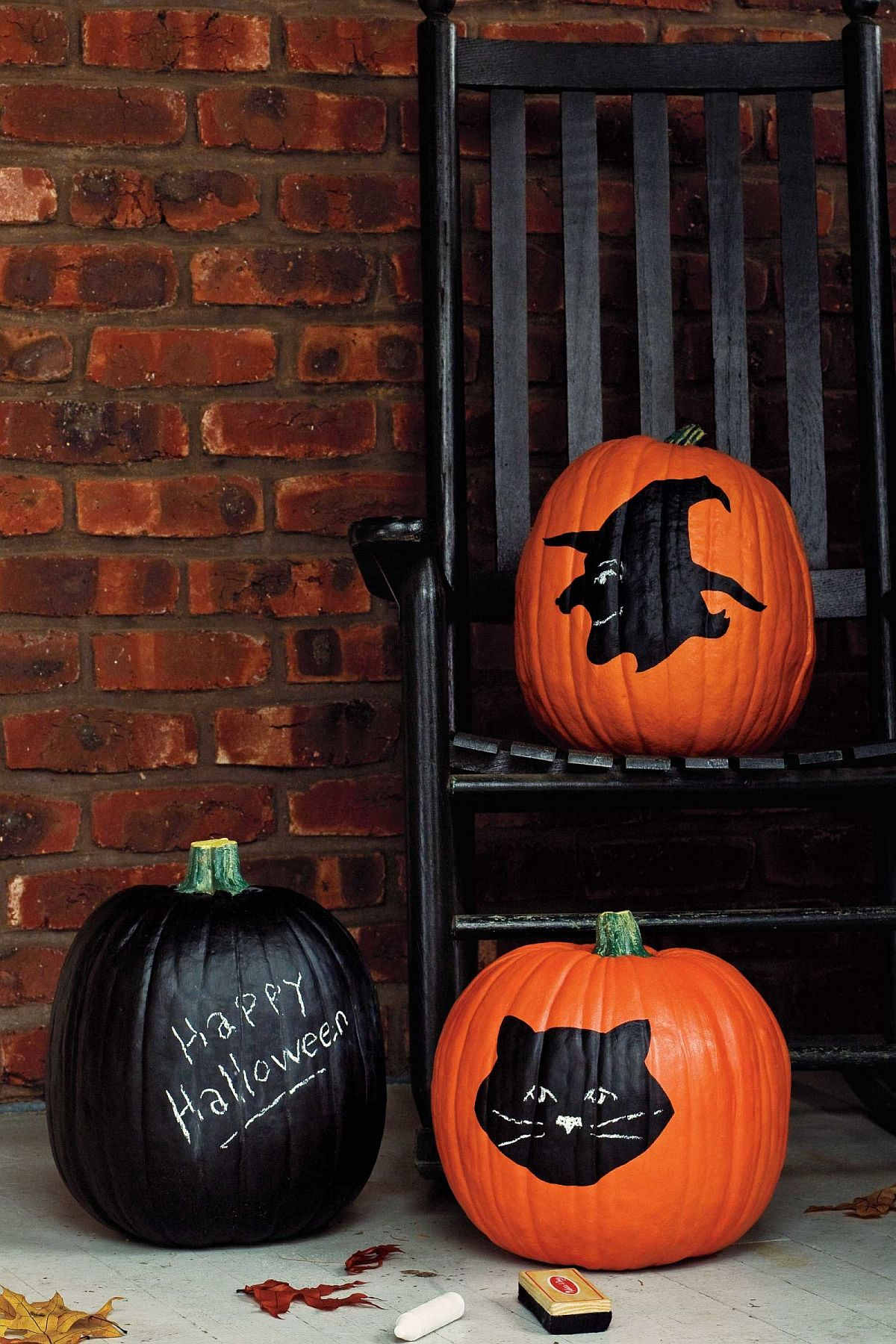 Use chalkboard and paint to create a cool pumpkin clad Halloween porch