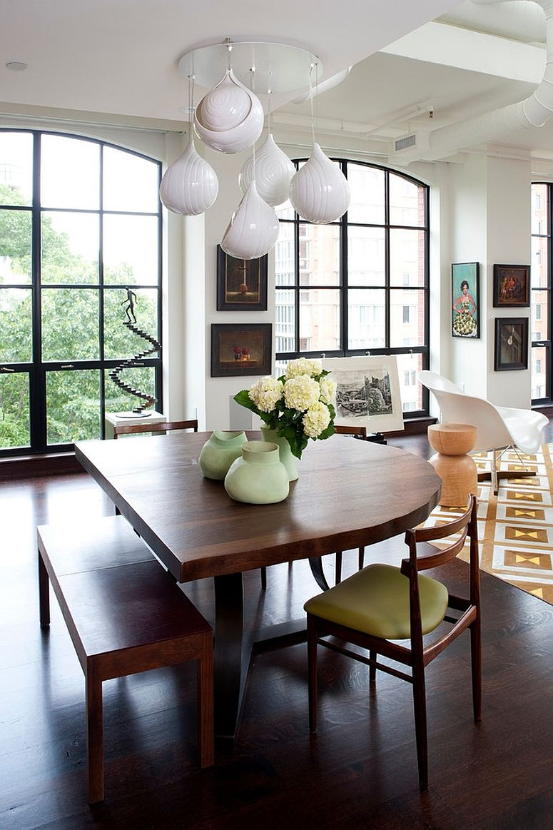 Both the dining table and the pendants move away from the mundane here