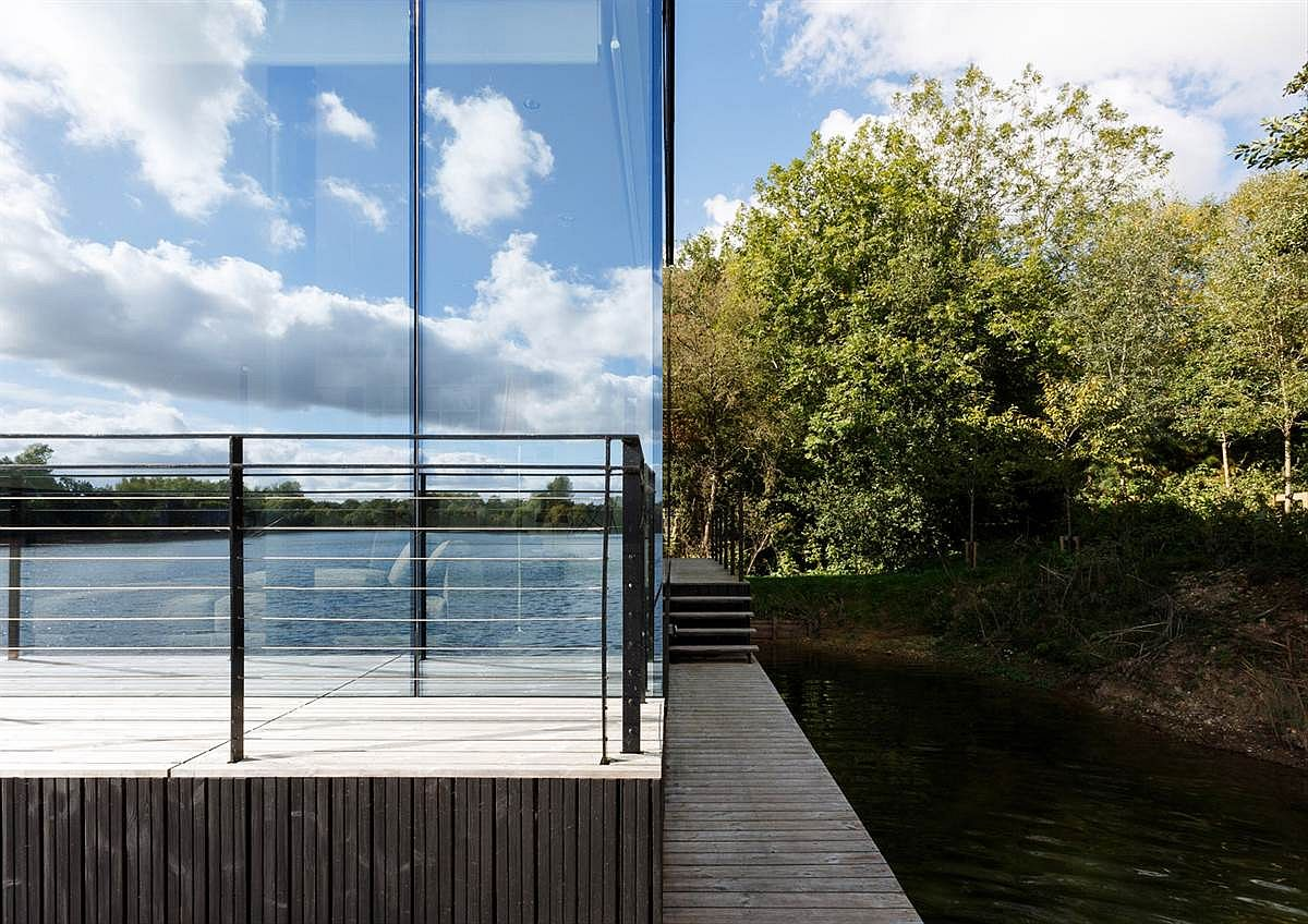 Reflective glass panels mirror the landscape and sky beautifully