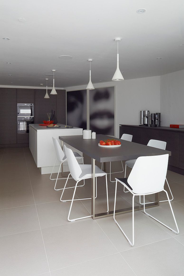 Slim white pendants are perfect for the small apartment dining room with contemporary style